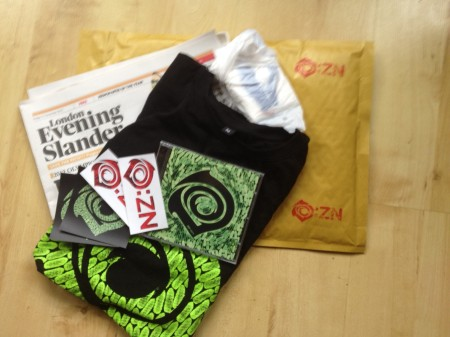 An O:ZN mailout pack, including CD, T-Shirt, stickers, survival kit and a copy of The Evening Slander.